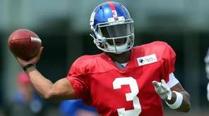 Giants quarterback Geno Smith throws a pass during training