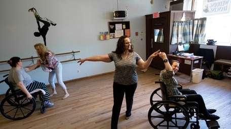 Stephanie Kanet, 32, above left, dances with Marjory
