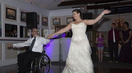 Lauren DeMarco dances with her father, John Creutzberger,
