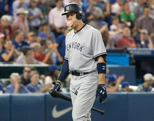 New York Yankees catcher Gary Sanchez goes out