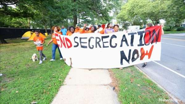 Members of New York Communities for Change protested