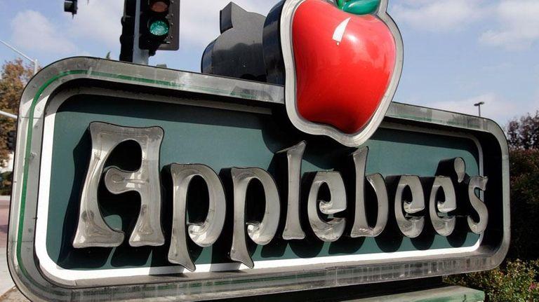 The exterior of an Applebee's sign near a