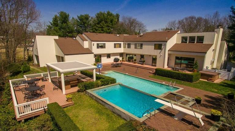 The 2.1-acre parcel includes a backyard with a