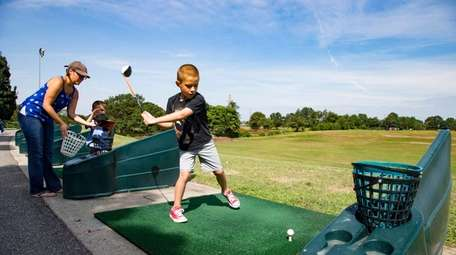 Christopher Alden, 6, of North Bellmore, hits a