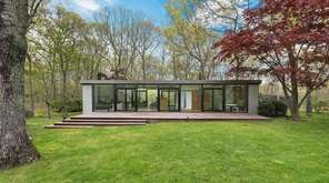 The Amagansett home's open-plan features aged pine floors,