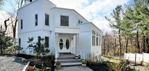 A Port Jefferson Contemporary listed for $699,000 has