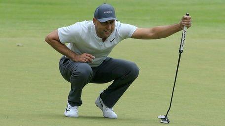 Derek Jeter lines up a putt during the