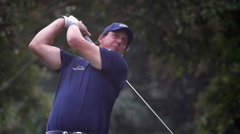Phil Mickelson of the United States plays his