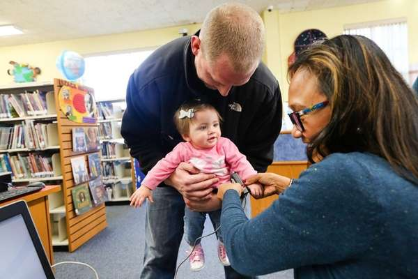 Patrick Eannotti of Glen Cove holds his 10-month-old