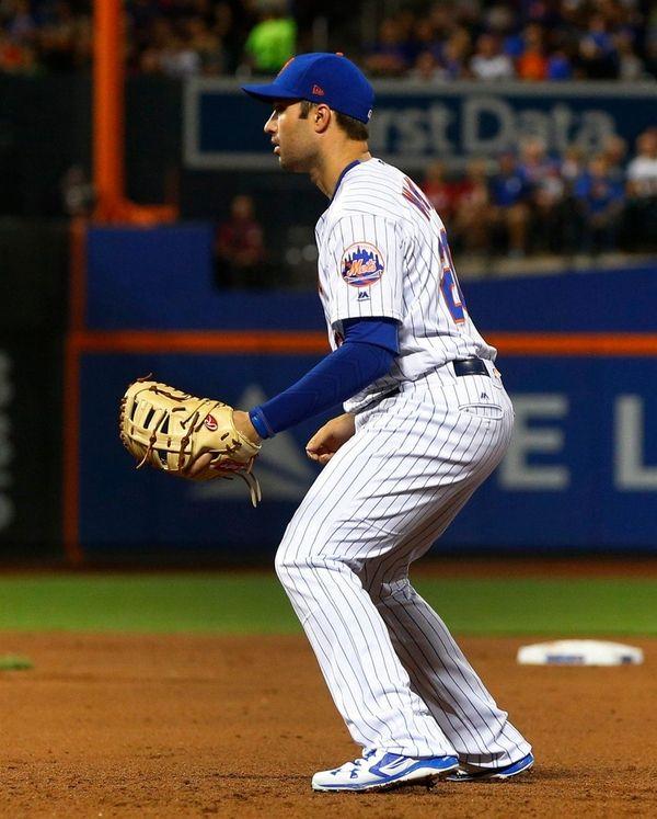 Neil Walker of the New York Mets defends