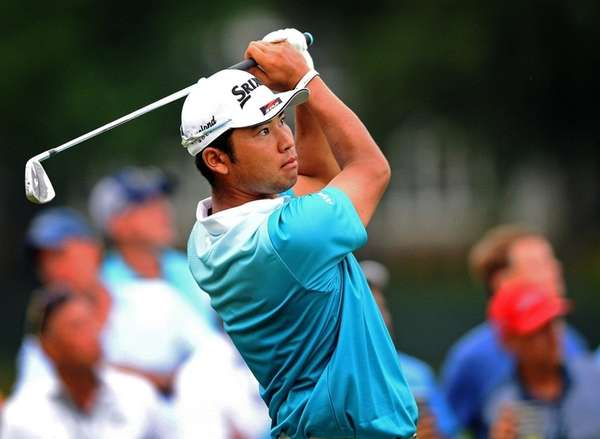 Hideki Matsuyama watches the flight of his ball
