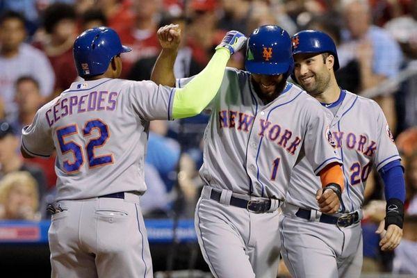 The Mets' Yoenis Cespedes, left, Amed Rosario, center,