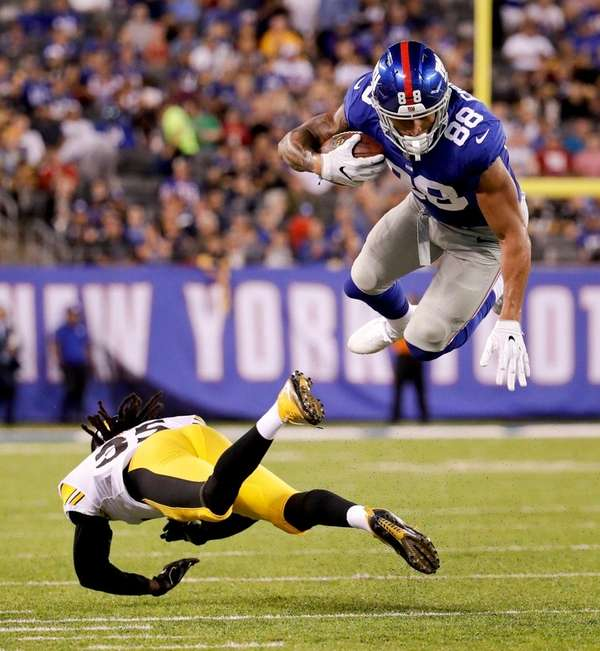 Giants tight end Evan Engramis tripped up by