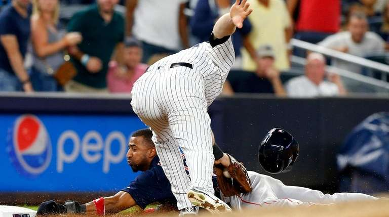 Eduardo Nunez of the Red Sox is tagged