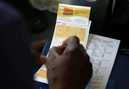 A customer picks numbers for his Mega Millions