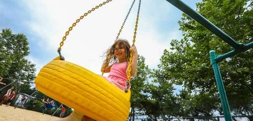 Lyra Prestia, 6, of Centerport, plays at a