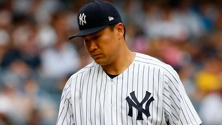 Masahiro Tanaka of the Yankees looks on against the Tigers