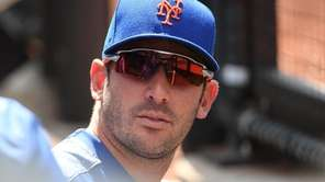 Mets pitcher Matt Harvey looks on against the Rangers at