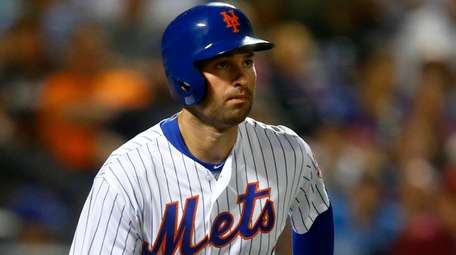 Neil Walker of the Mets grounds out against