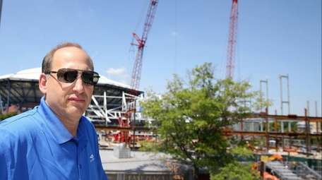 CEO Danny Zausner stands in front of the