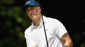 Jordan Spieth plays his shot from the fifth