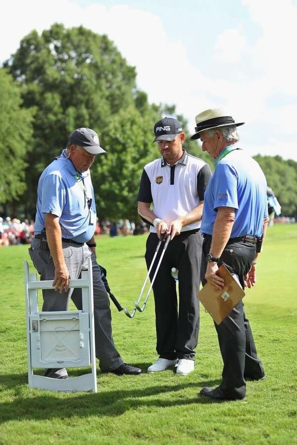 Louis Oosthuizen seeks a ruling for his bent