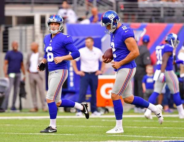 Aldrick Rosas, right, and Mike Nugent of the Giants