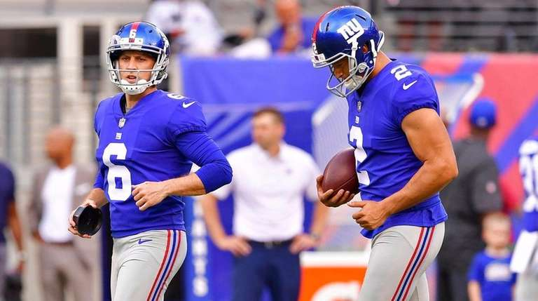 Aldrick Rosas, right,and Mike Nugent of the Giants