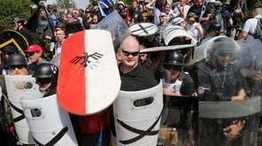 White nationalist demonstrators use shields as they guard