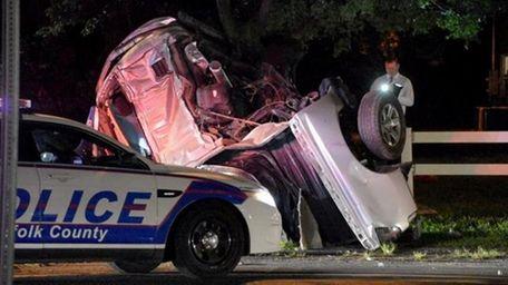 Suffolk County police investigate the scene of a