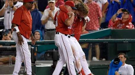 Washington Nationals' Bryce Harper, second from right, is
