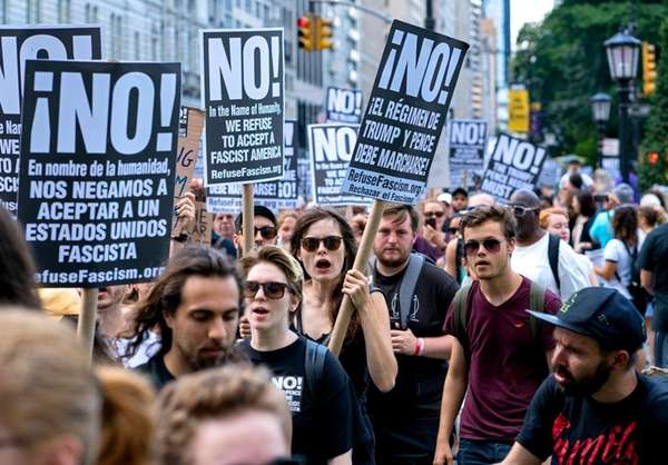 Protests break out around Trump Tower as president arrives