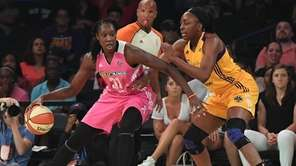 New York Liberty center Tina Charles drives the