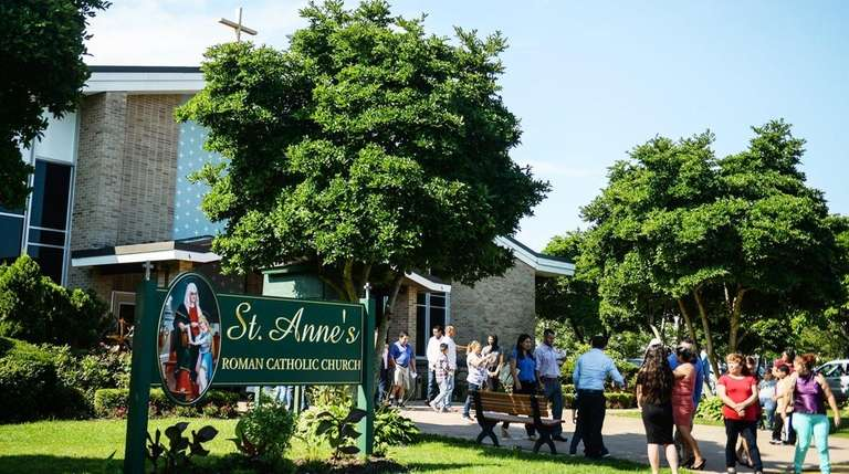 Parishoners exit St. Anne Catholic Church in Brentwood,