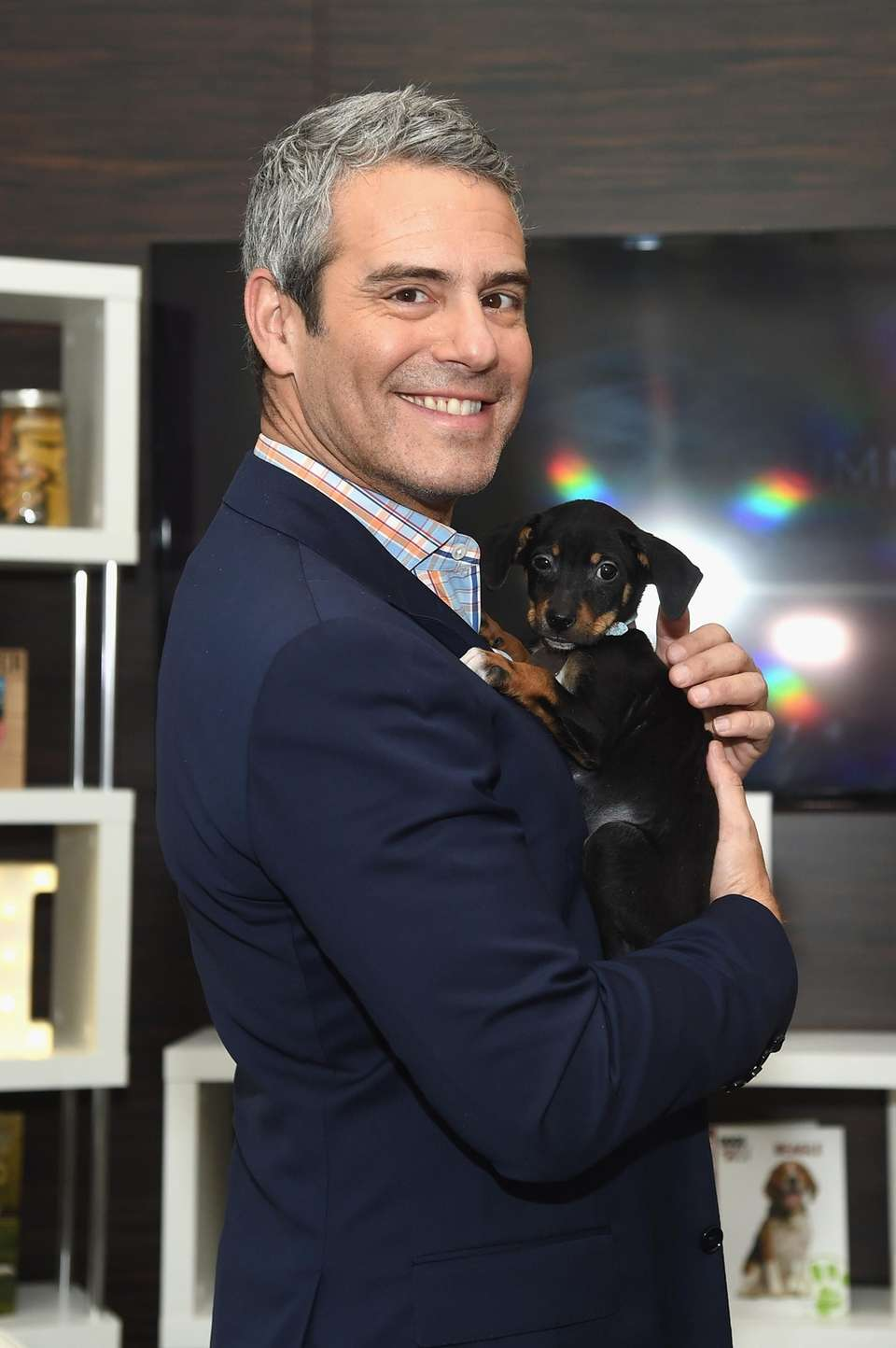 Talk show host Andy Cohen with a puppy