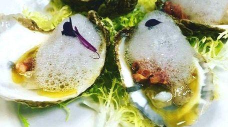 Smoked oysters with chorizo, cherry vinaigrette and lemon