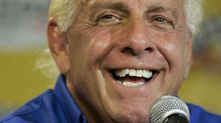 Wrestler Ric Flair addresses the media during a