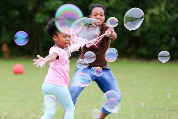 Melody Ofili of Brentwood, 4, makes bubbles with