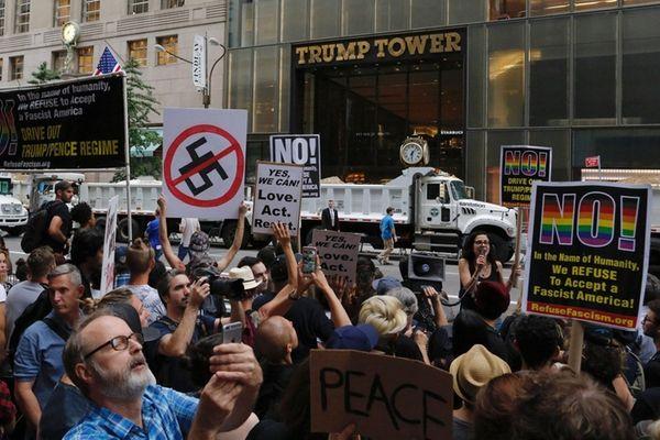 Demonstrators gather near Trump Tower in Manhattan to