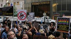 Demonstrators gather near Trump Tower in Manhattan to