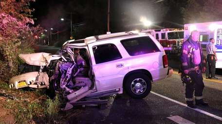 Firefighters respond after a crash on Connetquot Avenue