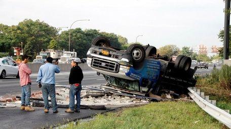 An overturned truck is seen after a crash