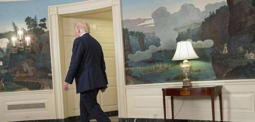 President Donald Trump walks away after delivering a