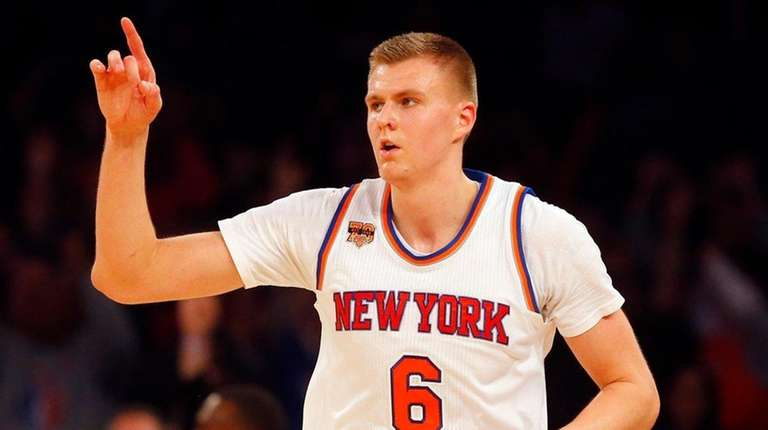 Knicks forward Kristaps Porzingis reacts after hitting a