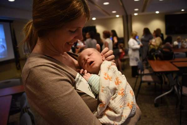Megan Warfield of Babylon and her three-week-old son,