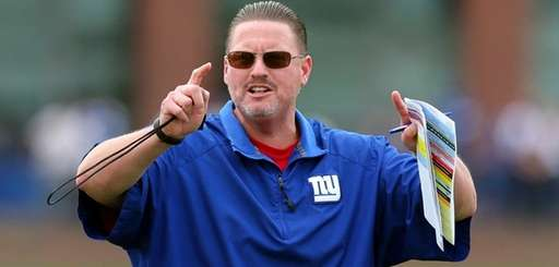 Giants head coach Ben McAdoo runs practice during