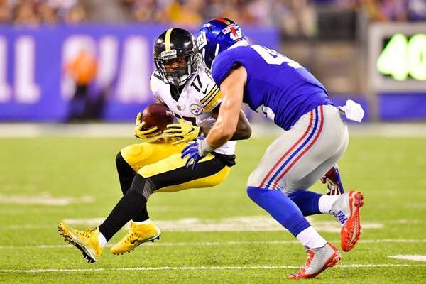 Eli Rogers of the Steelers is tackled by Calvin
