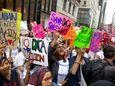 Activists on Tuesday, Aug. 16, 2017 near Trump