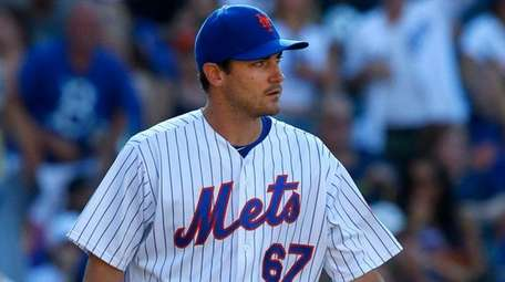 Seth Lugo of the Mets looks on after