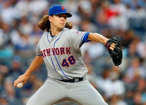 Jacob deGrom of the Mets pitches against theYankees